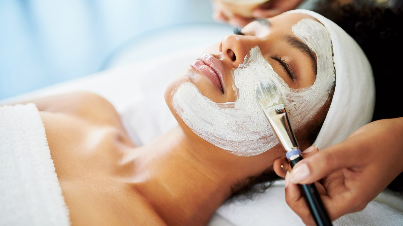 Shot of an attractive young woman getting a facial at a beauty spa
