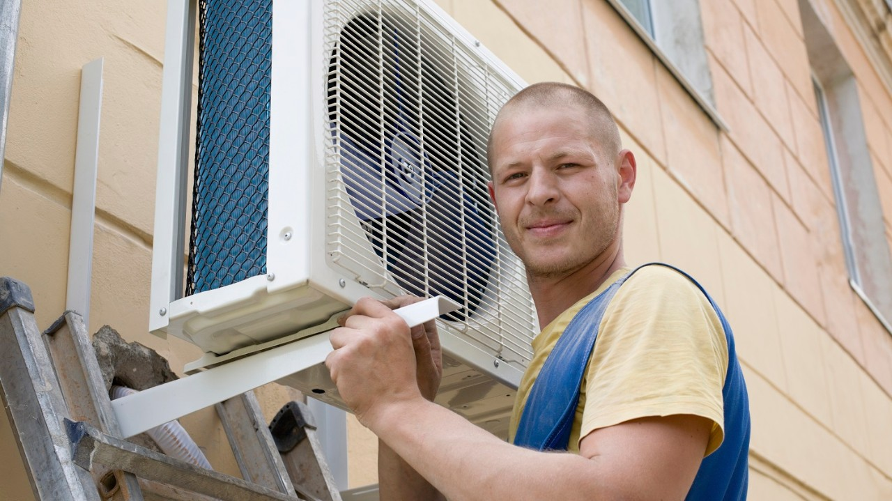 installer sets a new air conditioner